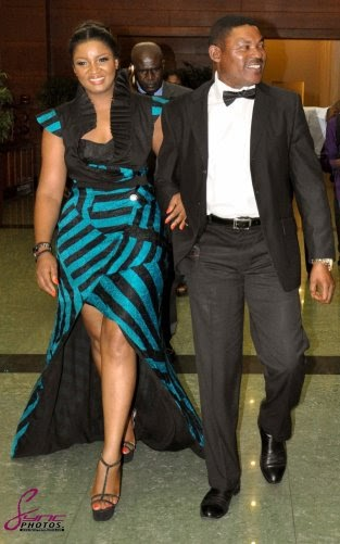 Omotola arriving with her husband