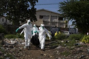 Burial team remove body of suspected Ebola virus victim in Freetown
