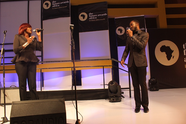 Waje & OC Ukeje perfoming the National Anthem (726x485)