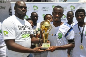 Ufuoma Dogun Manager Events Etisalat Nigeria presenting trophy to team Unlimited SMS winners of the Five a side football tournament