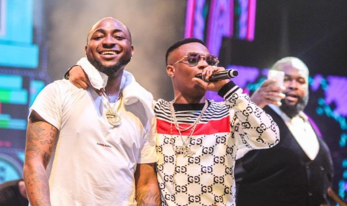 Davido and Wizkid on stage. [PHOTO CREDIT: Daily Post Nigeria]